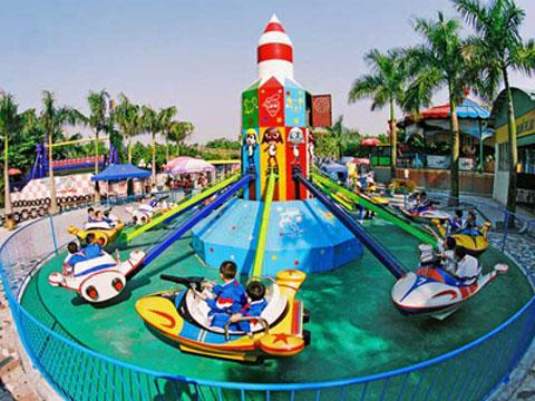 Kiddie Plane In Amusement Park